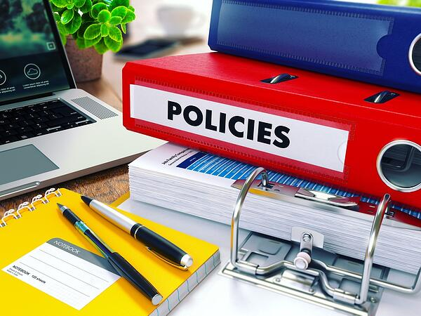 Policies - Red Ring Binder on Office Desktop with Office Supplies and Modern Laptop. Business Concept on Blurred Background. Toned Illustration.-1