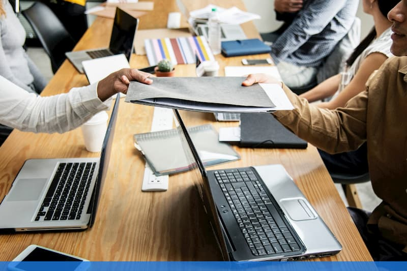 Employee meeting handing over folder
