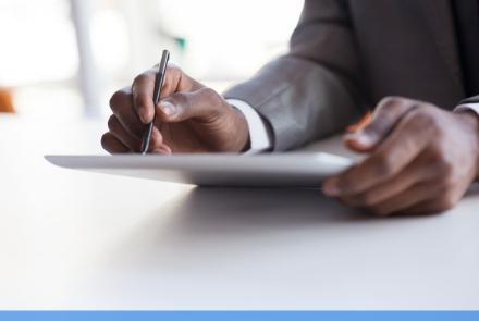 employee writing down data